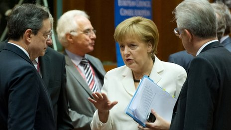 German Chancellor Angela Merkel (C) talks with European Central Bank President Mario Draghi and Italian Prime Minister Mario Monti (R)