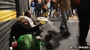 A man busks in the streets as young Mexicans go home after a political demonstration in Mexico City's main square on 23 June 2012