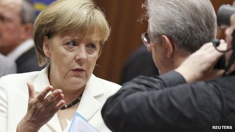 Germany Chancellor Angela Merkel talks to Italy's Prime Minister Mario Monti