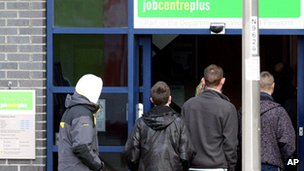People queuing outside a job centre