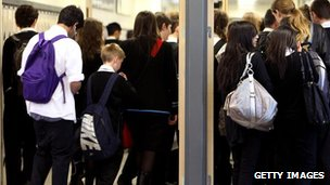 Teenagers in school corridor