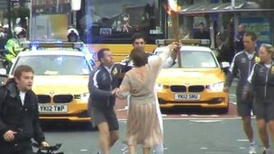 Gilda Porcelli attempts to touch Olympic torch in Leeds, 25 June 2012,