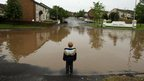 This boy is looking out at a flooded road in Lisburn in Northern Ireland.