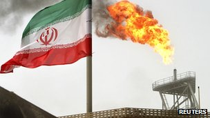 Iranian flag and oil platform