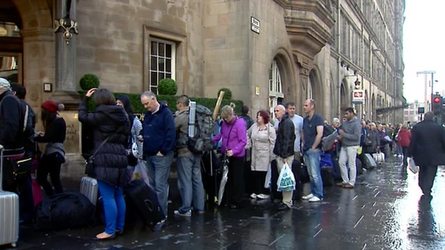 Rail passengers queue at Glasgow's Central Station