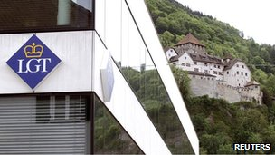 The logo of LGT Group is seen in front of the princely castle in Liechtenstein's capital Vaduz