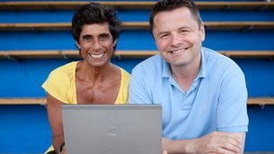 Chris Hollins and Fatima Whitbread with a laptop