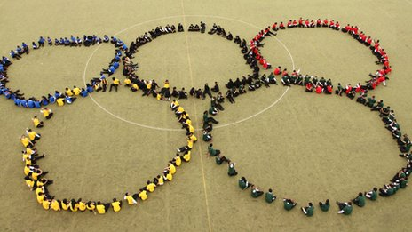 The Holyhead School pupils form the Olympic rings