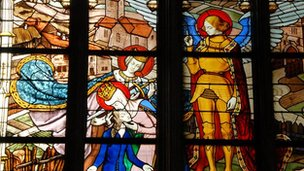 Stained glass window depicting Joan of Arc in the Cathedral Sainte Croix