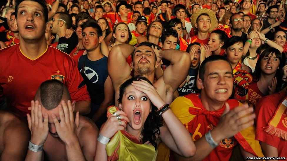Spanish fans react while watching on a giant outdoor screen
