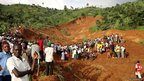 Residents of Bududa mill around an area where people were buried alive following a mudslide in Bunamulembwa village in eastern Uganda