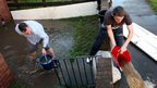 People empty buckets of water from their gardens in South Tyneside
