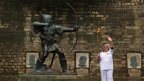 Torchbearer Barbara Green beside the Robin Hood statue, Nottingham, 29 June 2012