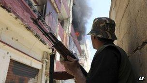 A Sunni gunman fights in Tripoli, Lebanon. Photo: June 2012