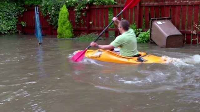 Man in canoe in back garden