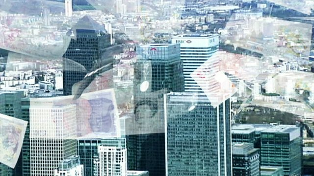 Banks in Canary Wharf with graphic image of money falling down