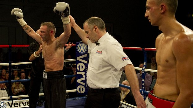 Scott Harrison enjoys victory over Gyorgy Mizsei Jr