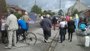 Spectators are beginning to assemble in Newtown, Staffordshire