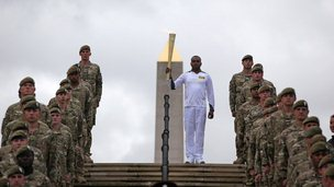 Corporal Johnson Beharry carries the flame at the Armed Services Memorial