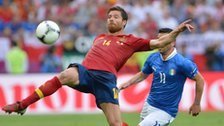 Spain's Xabi Alonso against Italy