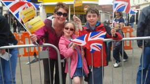 Rachel Kirby and family wait for the torch