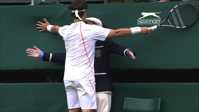 Fabio Fognini accidentally embraces a line judge