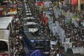 Protesters and trams on Hong Kong street - 1/7/12