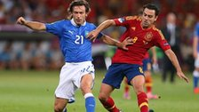 Pirlo is pressurised by Xavi