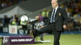Spanish coach Vicente Del Bosque kicks a football