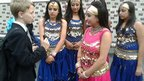 School Reporter with Bollywood dancers
