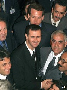 Bashar al-Assad shakes hands with Baath Party members before being elected chairman of its Regional Command in 2000