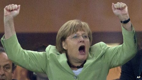 Angela Merkel cheers the German football team during the Euro 2012