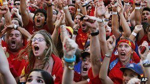 Spanish fans celebrate during the viewing of Euro 2012 soccer championship final match between Spain and Italy at the Fan Zone in Madrid