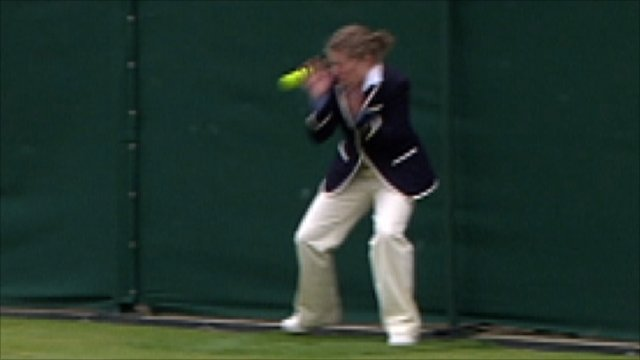 Wimbledon line judge hit by ball