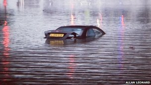 Partly submerged car