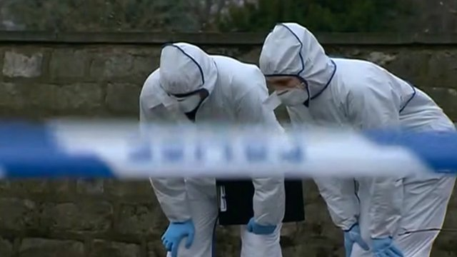 Forensic teams at crime scene