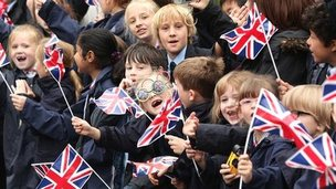 Schoolchildren watch the relay in Dunchurch