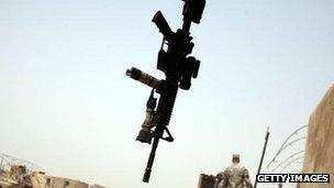 A gun hangs from truck door at US military base Kalsu on July 18, 2011 in Iskandariya, Babil Province Iraq.
