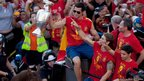 Alvaro Arbeloa (L) of Spain celebrates on a double-decker bus during the Spanish team's victory parade in Madrid, Spain, 2 July 2012