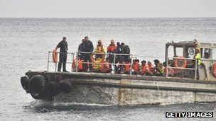 A barge carrying rescued suspected asylum seekers nears Christmas Island on 22 June, 2012
