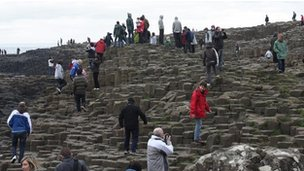 Tourists at the Giant&#039;s Causeway