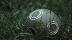 Grey football in grass
