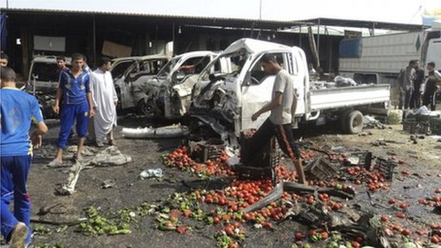 Wrecked cars and street strewn with vegetables in Karbala, 3 July, 2012.