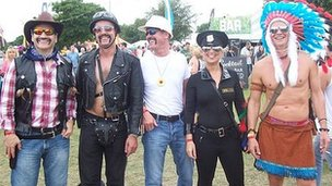 Festival-goers dressed as the band The Village People