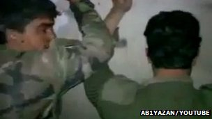 Two detainees from Syrian government forces in a video purportedly uploaded by rebel forces