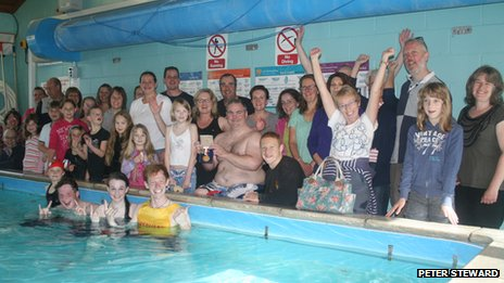Paralympic gold medallist Oliver Jones (centre) with swimmers at Hethersett 24-hour swimathon