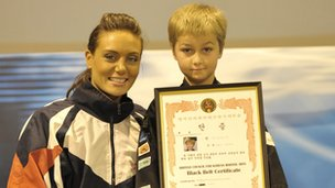 Jack Mylam receiving his black belt in martial arts