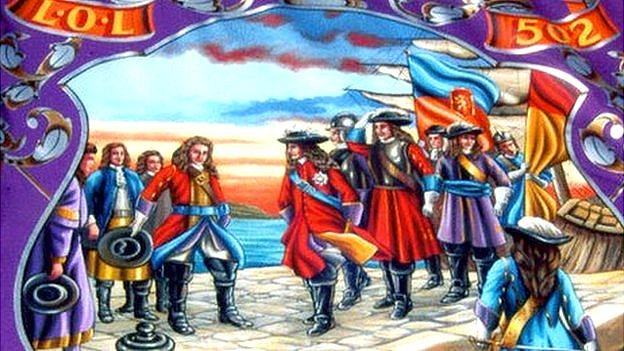This banner depicts William of Orange arriving at Carrickfergus, in what is now Northern Ireland. He brought with him the largest invasion force Ireland has ever seen and used it to defeat James II at the Battle of the Boyne.