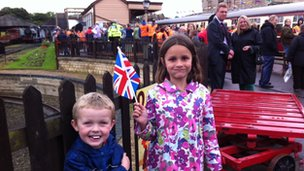 Ewan and Daisy wait for the torch