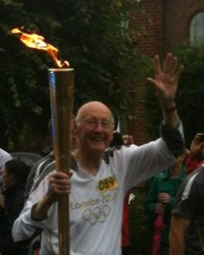 John Peake with the torch